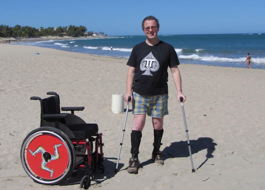 Wheelchair and walking sticks on Cabarete Beach
