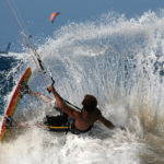 Kitesurfer spraying water