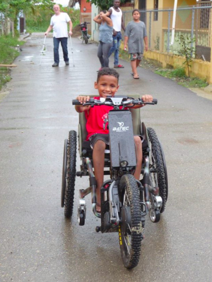 Child in Dominican Republic playing in my wheelchair