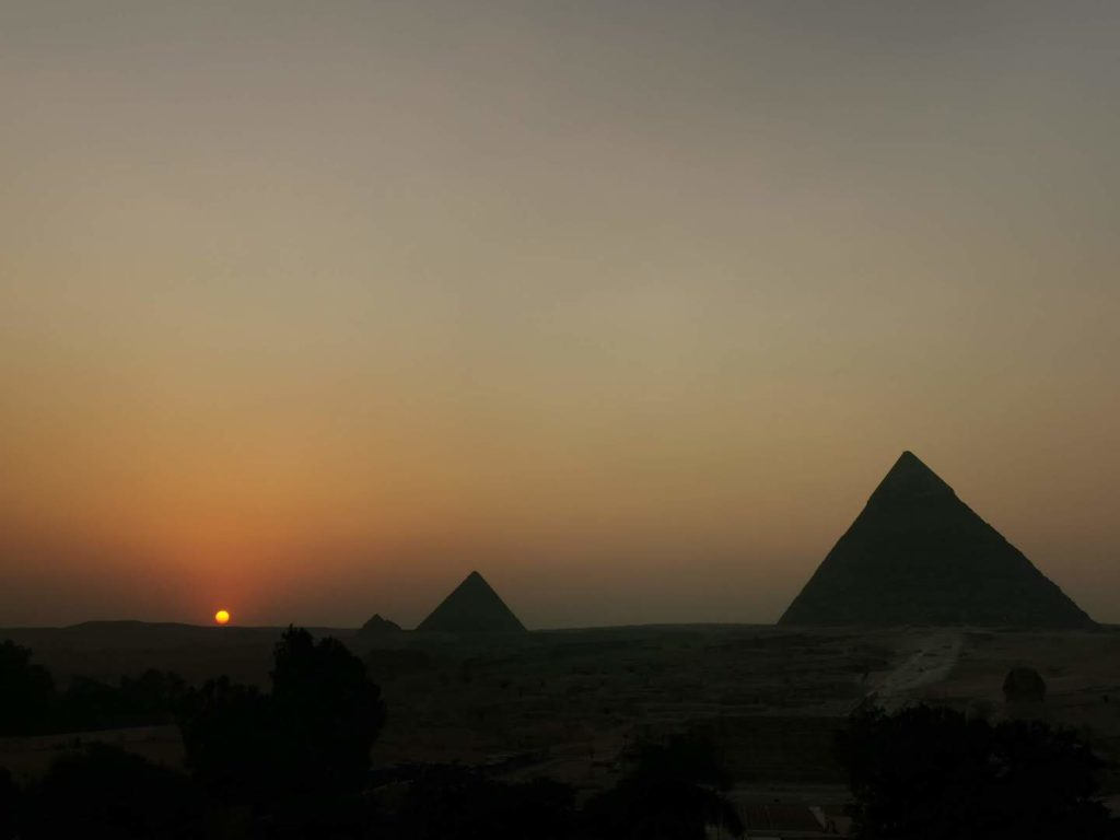 Sunset behind the pyramids