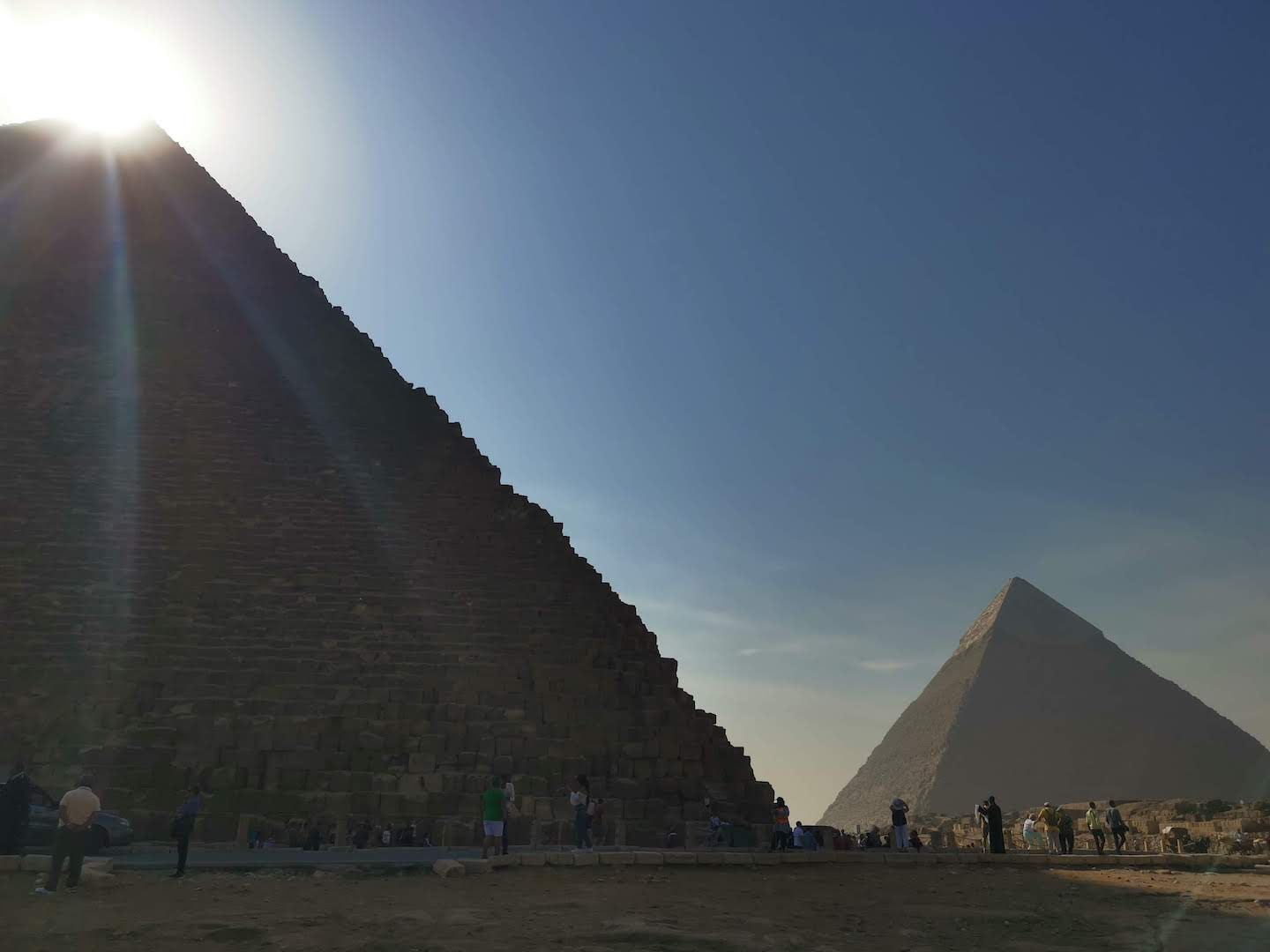 Sun rising over pyramid